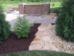 Hardscapes and softscapes combine to create an inviting and functional landscape.